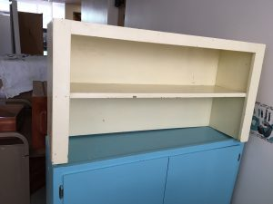 Picture of a cabinet with a shelf